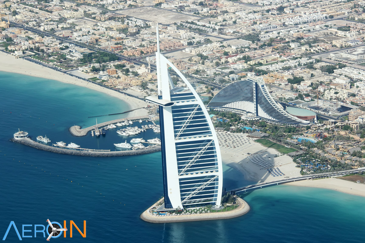 how to travel from dubai to qatr