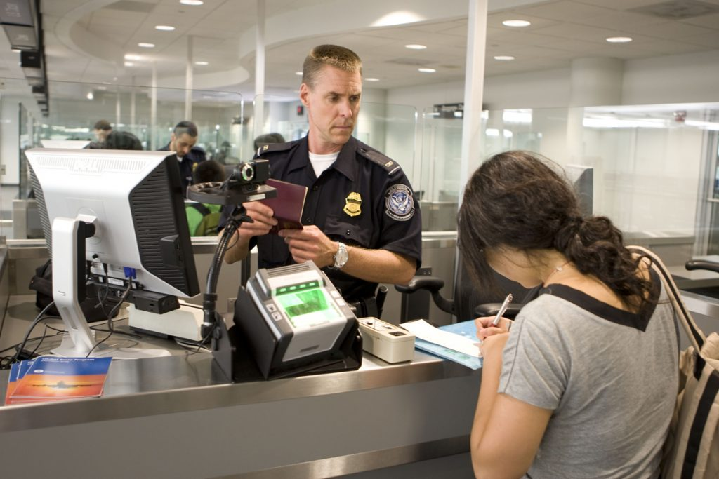 CBP Officer processes a passenger into the United States at an airport.