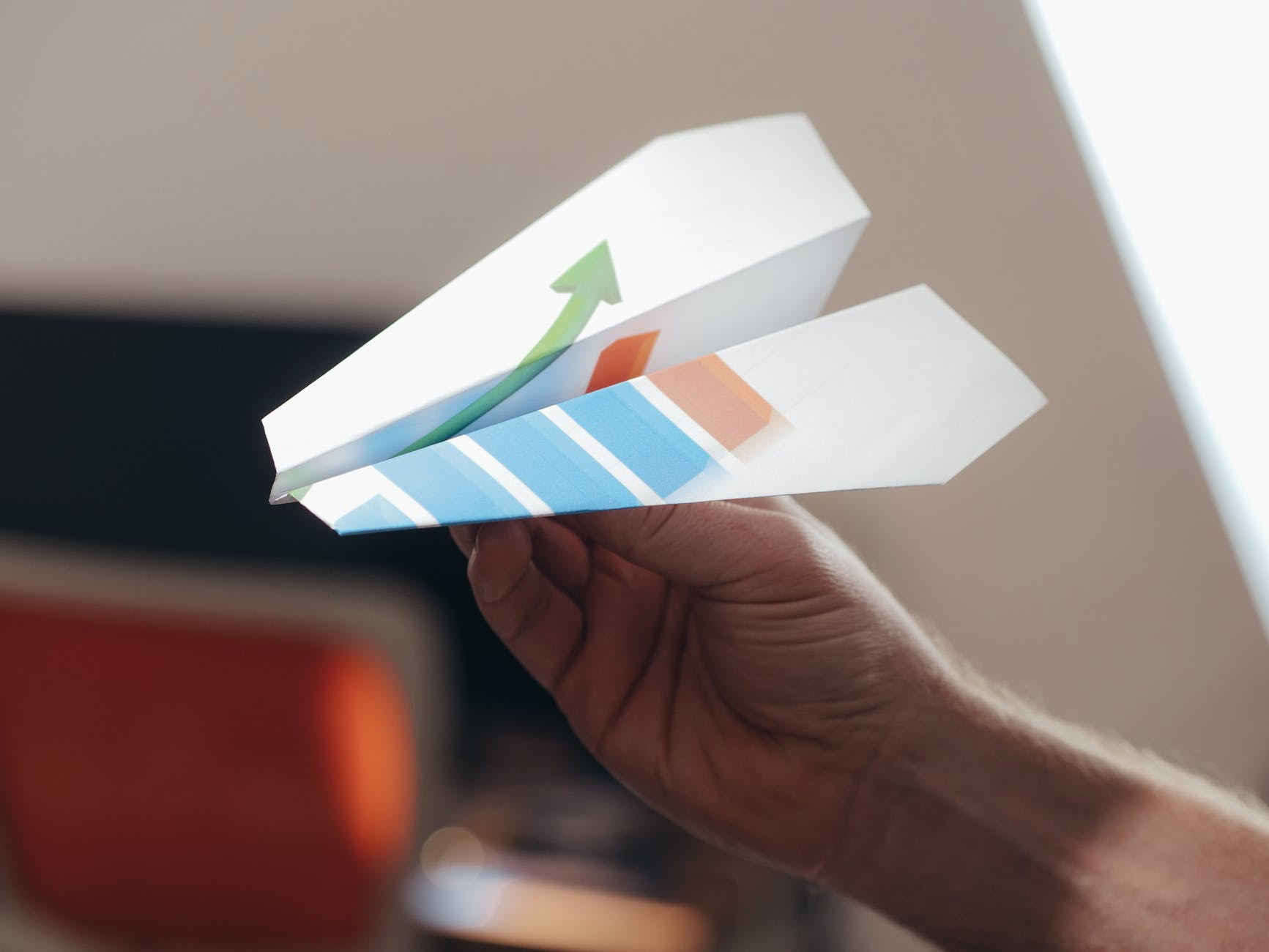 a person holding paper airplane